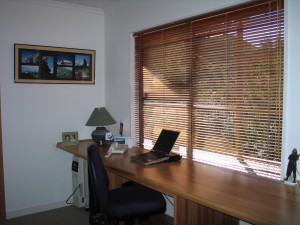 A very tidy shot of my office when I lived in New Zealand. On the wall are some photos of a trip to Makalu in the Himalayas. On the right is a small cut out of Aragorn from Lord of the Rings.